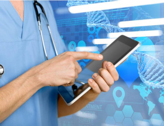 A doctor holds a tablet.